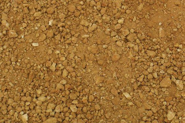 Compactable fill soil being unloaded from 3m skip bin in Brisbane